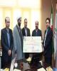 اهدای چک یک میلیارد ریالی بانک رفاه به بیمارستان میلاد شهریار